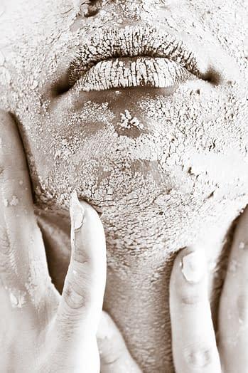 dark skin woman with dry skin facial