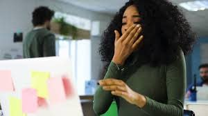 burned out , overworked  black woman sleep at the job