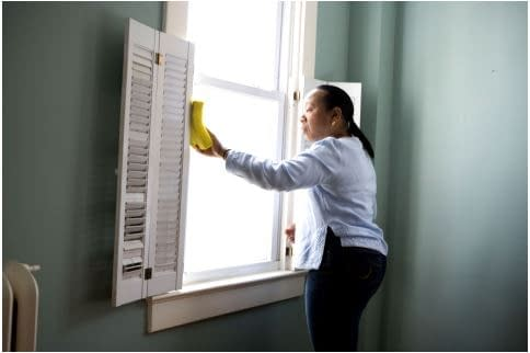 woman cleaning.  Is It